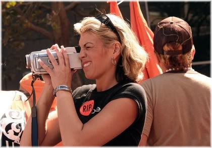 Woman holding camcorder.