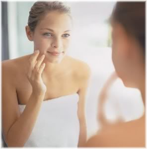 girl looking at face in mirror