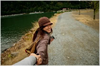 woman holding man hand