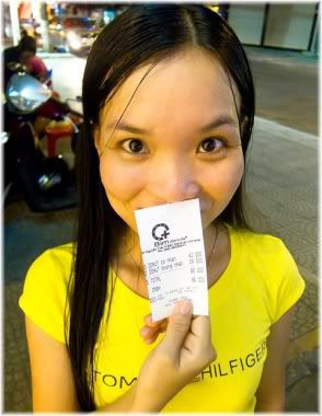 girl holding receipt