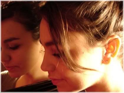 woman looking behind into mirror