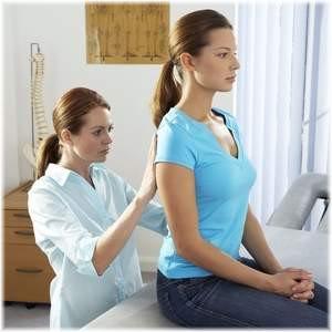woman examining woman's back