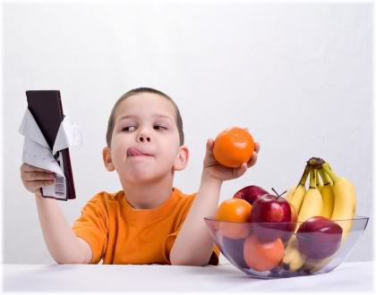 boy holding chocolate and orange
