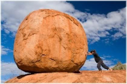 pushing boulder