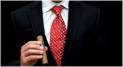 hand holding cigar man suit