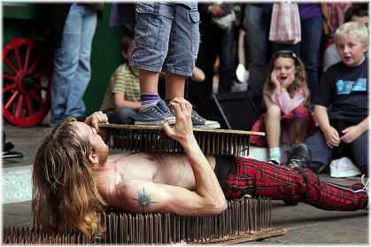 man underneath bed of nails