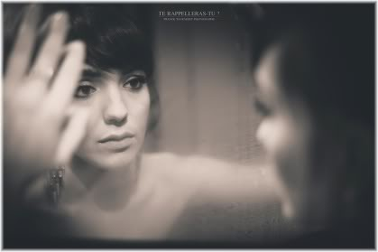 woman leaning into mirror