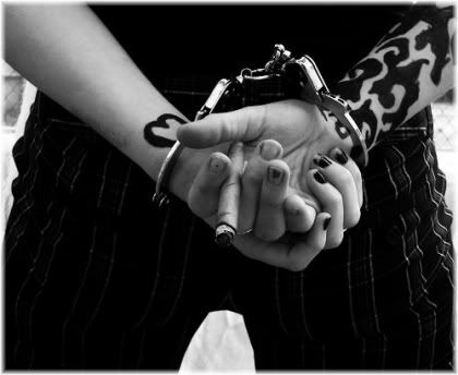 hands handcuffed behind back cannabis