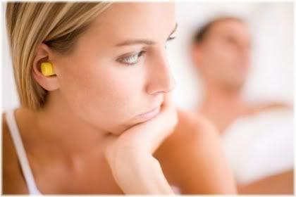 woman wearing ear plugs