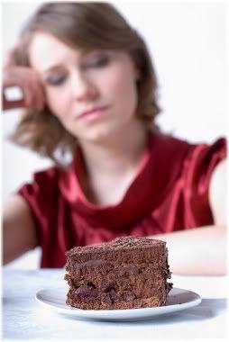 woman staring at cake