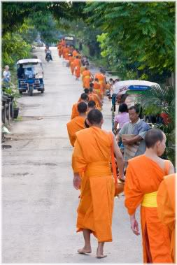 monks walking down road