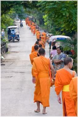 monks walking down road