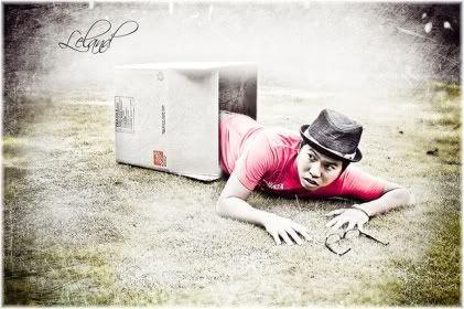 man climbing out of box