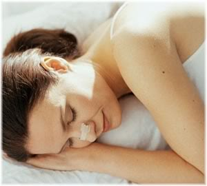 person sleeping with nasal strip