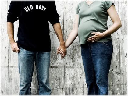 man holding hands with pregnant woman