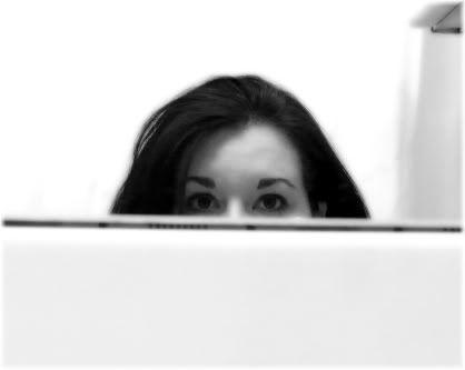woman peering over desk