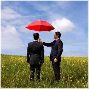 man holding umbrella over man