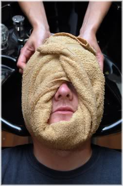 man with hot towel treatment