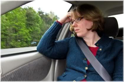 woman in car unhappy
