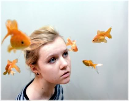 goldfish swimming around girl's head
