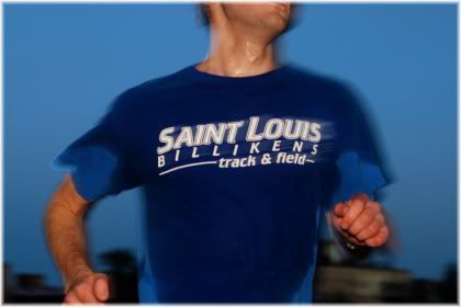 man running with sweaty t-shirt