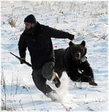 man running away from bear