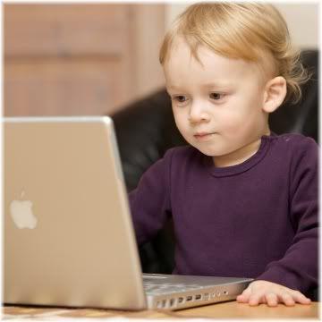 child using mac laptop