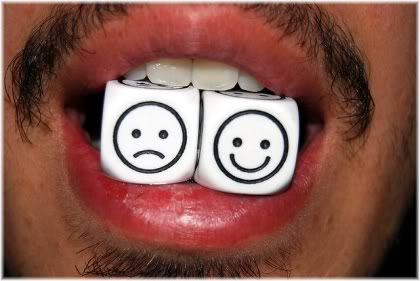 happy sad faced dice in mouth