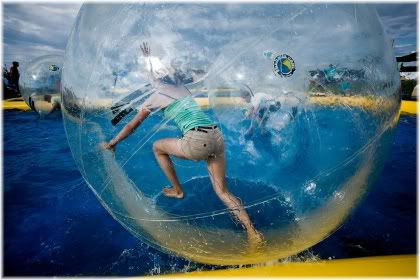 person in ball on water