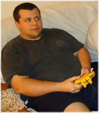 obese boy playing video game