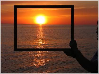 holding frame around sun