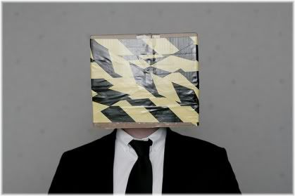 man with box over head