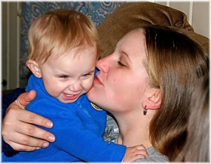 mother kissing child