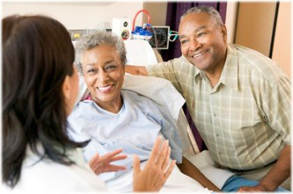 talking with patient in hospital bed