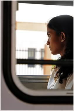 woman looking out of window on train