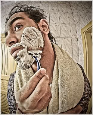 man shaving face