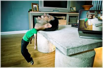 man with big head resting backwards on table