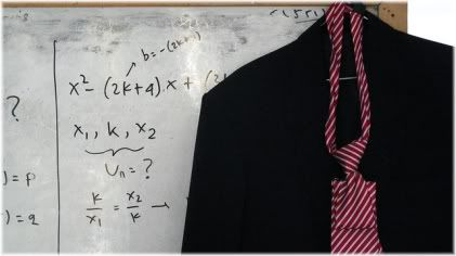 coat hanging on whiteboard with equations
