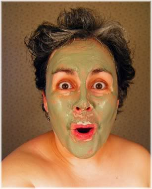 woman with clay mask treatment