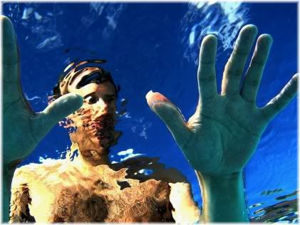 man with hands on surface of water