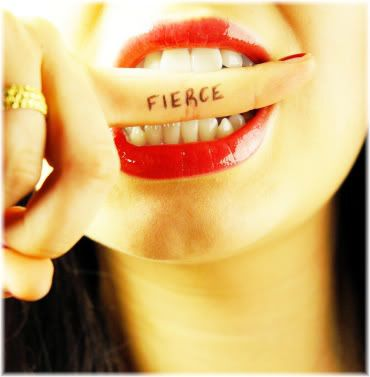 woman biting finger with fierce written on it.