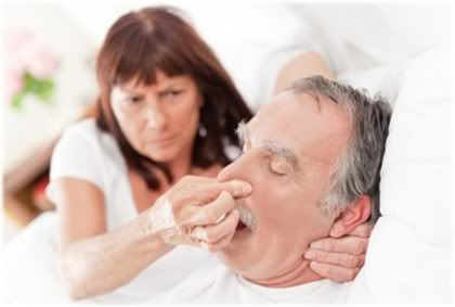 woman covering nose of snorer