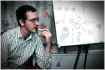 man thinking next to whiteboard