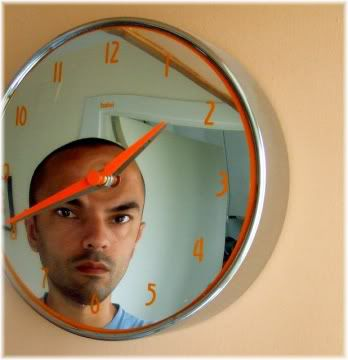 man face reflection in wall clock