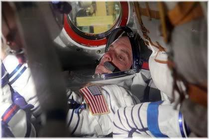 astronaunts in shuttle