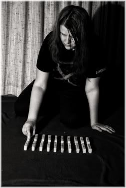 girl arranging sticks neatly