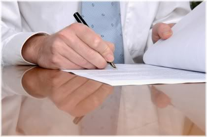 man signing sheet