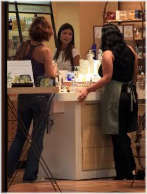 women at cosmetics counter