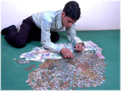 man sorting coin collection