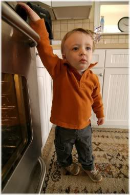boy with hand on stove